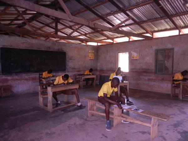 Students taking the Ghana Junior Secondary School exams at Asueyi Primary School