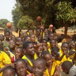 School children at Asueyi Primary school display excitement about CP4K