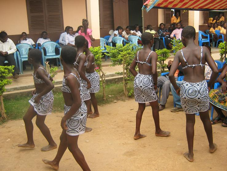 School children at Piase Elementary school dance to traditional music during Give Back Africa donation event